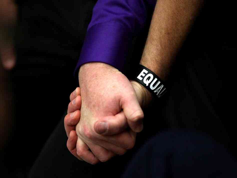 A couple holds hands during a sit-in protest prompted by same-sex couples being denied marriage licenses in San Francisco.