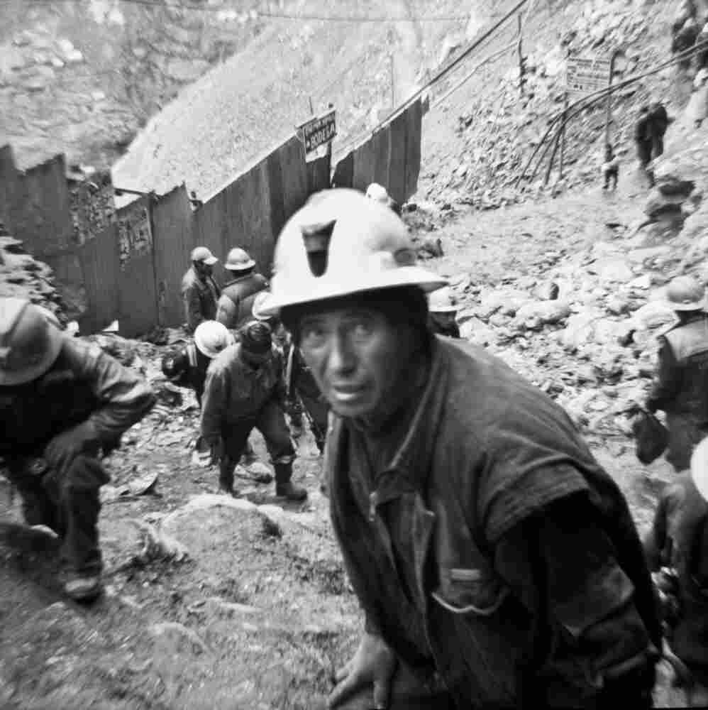 A miner makes his way up a steep trail during a shift change in La Rinconada, Peru. Revolving shifts allow miners to see daylight every few days.