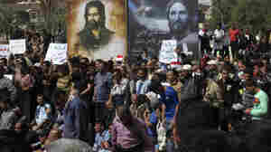 Iraqis' Anti-Government Rally Cramped By Curfew