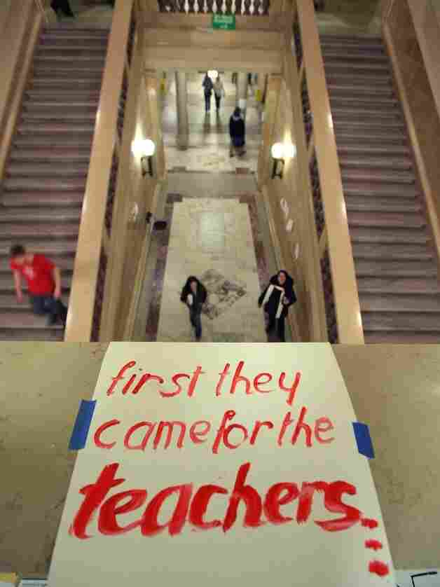 A sign supporting teachers is taped to the railing above a stairway in the Wisconsin state Capitol last month, as activists protested what they call an anti-union measure.