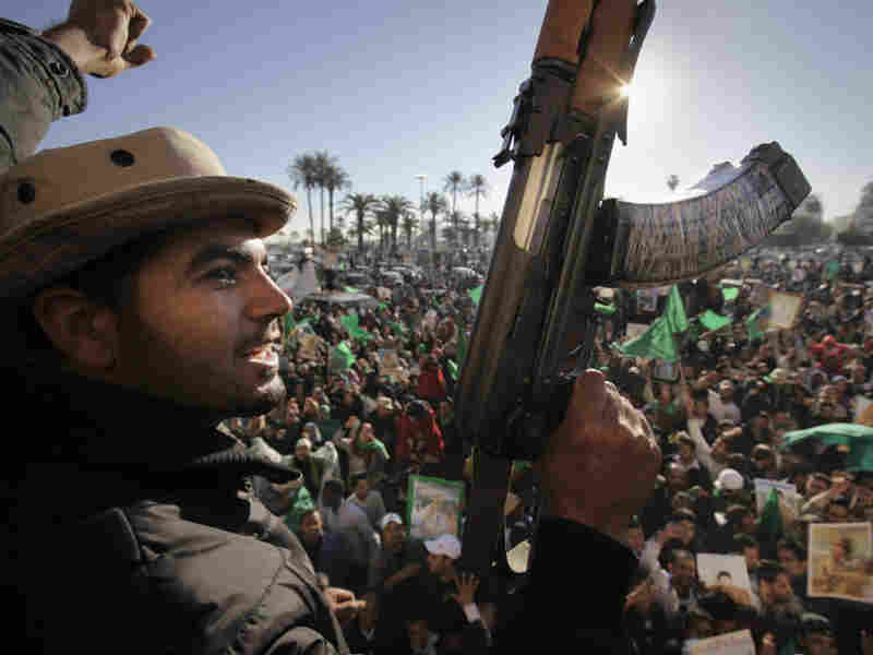 Pro-Gadhafi soldiers and supporters gather to celebrate in Green Square, Tripoli, Libya, on Sunday.