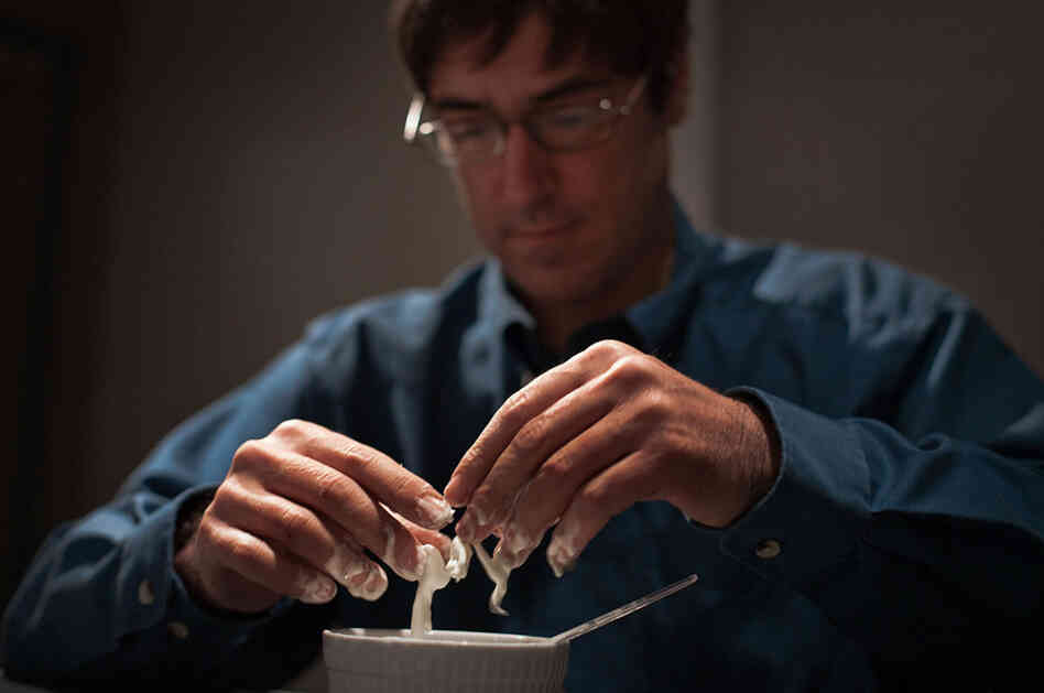 NPR science correspondent Richard Harris plays with oobleck. One