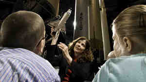 Educators at the National Museum of the U.S. Air Force teach students about spaceflight. The museum is one of many vying to display a space shuttle.