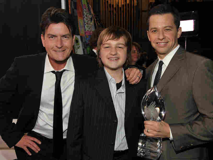 Actors Charlie Sheen (from left), Angus T. Jones and Jon Cryer pose backstage during the 35th Annual People's Choice Awards at the Shrine Auditorium on Jan. 7, 2009, in Los Angeles.