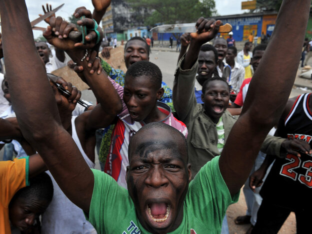 Residents gather on the street where security forces loyal to disputed incumbent leader Laurent Gbagbo, opened fire on demonstrators, killing