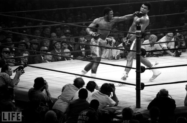 Muhammad Ali dodges a hook thrown by Joe Frazier.  Knocked down in the 15th and final round, Ali lost by a unanimous decision, his  first professional defeat.