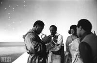 Joe Frazier tests out a band member's trumpet on the set of NBC's long-running Kraft Music Hall variety show, one of many stops on the media circuit preceding the fight.