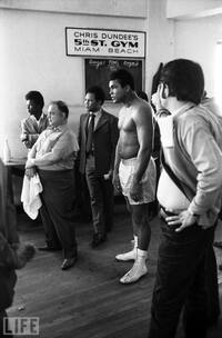 Ali, along with Puerto Rican light heavyweight Jose Torres (in  suit) and others, gather at legendary boxing promoter Chris  Dundee's gym in Miami Beach, Fla., in February 1971.