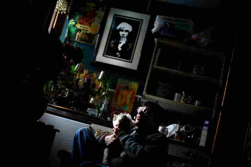 Martin Michael Fitzgerald III sits in his studio apartment with his dog Miss Lilibet.