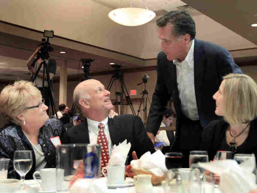 Mitt Romney worked the tables in New Hampshire at a Carroll County Republican dinner, Saturday, March 5, 2011.