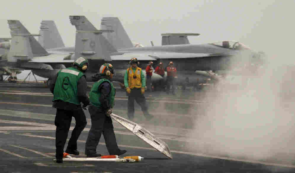 U.S. sailors on USS Harry S Truman aircraft carrier's flight deck in the Mediterranean Sea,  June 14, 2010.