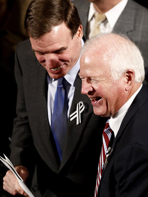 Sens. Mark Warner (D-VA, left) and Saxby Chambliss (R-GA), shown before the start of President Obama's State of the Union address in January. The two senators are part of the so-called Gang of Six — a bipartisan group that hopes to break a deadlock and reduce the federal deficit.