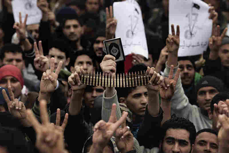 Libyan rebels gather for prayer on March 4. Loyalist forces have launched a fresh air strike on opposition territory in the east, while pumped-up opposition fighters pushed forward the frontline against Moammar Gadhafi's regime.