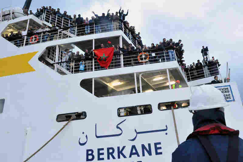 Moroccan expatriates arrive Sunday in the northern Moroccan port of Tangiers on a boat from the rebel-held city of Benghazi, Libya. Some 4,000 expats were repatriated by Moroccan authorities.