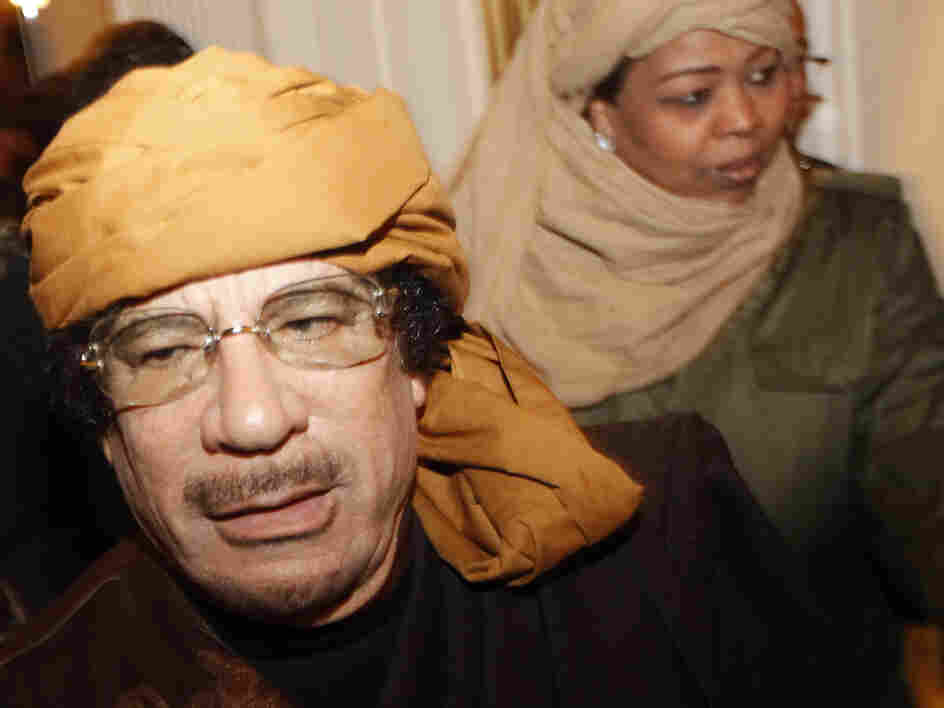 Moammar Gadhafi arrives at the Rixos hotel in Tripoli on Tuesday.