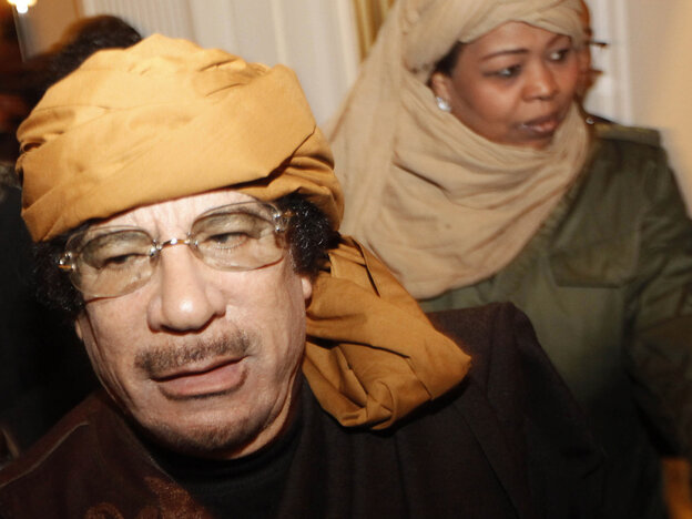 Moammar Gadhafi arrives at the Rixos hotel in Tripoli on Tuesday.