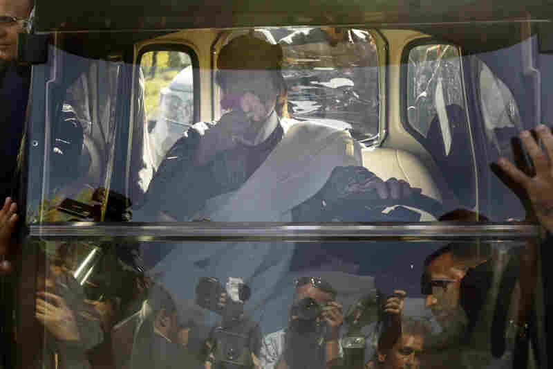 Gadhafi drives away in an electric golf cart after speaking in Tripoli on Wednesday after addressing supporters and the media.