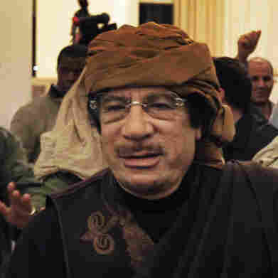 Libyan Leader Moammar Gadhafi arrives at a hotel to give television interviews in Tripoli, Libya, on Tuesday.