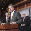 Sen. Joe Manchin (D-WV), accompanied by other senators, at a news conference on Feb. 8, 2011.