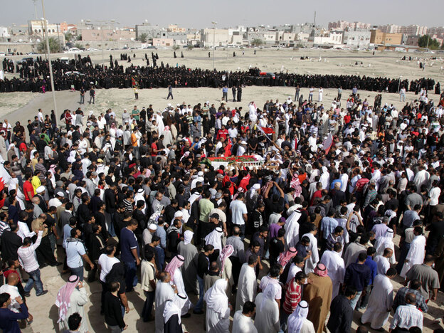 Thousands of Bahrainis gather in February at a cemetery in the poor western village of Karzakan, carrying the body of a man killed during anti-government clashes. Thousands of Shiites live in Karzakan, less than 10 miles from the capital, Manama.