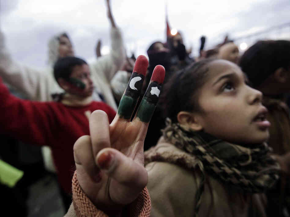 A young Libyan girl partaking in a demonstration against Libyan leader Moammar Gadhafi in Benghazi. Some argue that the protests roiling the region have been caused by things like youth unemployment, which in the Middle East and North Africa is among the highest in the world.