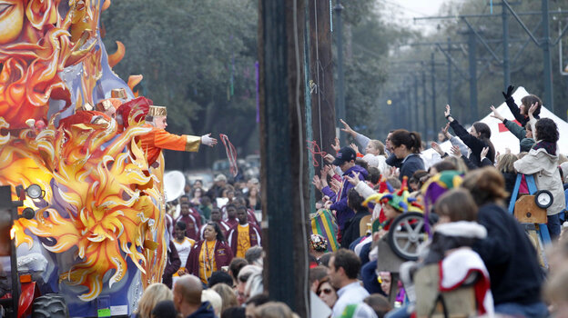 Revelers ask for beads during a pre-Mardi Gras parade in New Orleans, Monday, March 7, 2011.