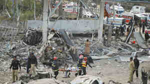 Devastation from a car bomb at a gas station in Faisalabad, Pakistan on March 8, 2011.