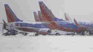 Southwest Airlines planes sat idle at Love Field airport in Dallas as snow fell on Feb. 4, 2011.