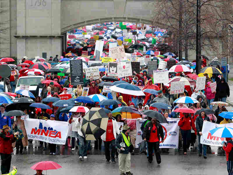 People opposing legislative efforts to do away with teachers' collective bargaining rights march to the Legislative Plaza for a March 5 rally in Nashville, Tenn. Protesters from the Tea Party as well as the Tennessee Education Association converged on the state Capitol to voice competing views on the issue.