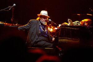 After Hurricane Katrina, Dr. John stepped up his relief effort by hosting fundraising concerts and recording benefit albums. His album City That Care Forgot earned him his fifth Grammy. Here, he performs during a concert in 2004.