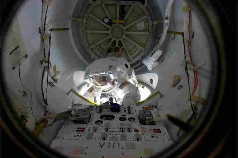 Alvin Drew emerges from an airlock on the space station on Feb. 28. Drew was the 200th person to perform a spacewalk.