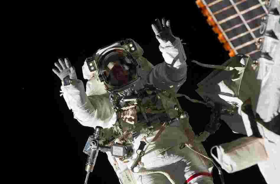 During the mission, astronaut Steve Bowen performed a spacewalk with fellow astronaut Alvin Drew to fix a pump on the International Space Station. Bowen is seen here strapped to a robotic arm.