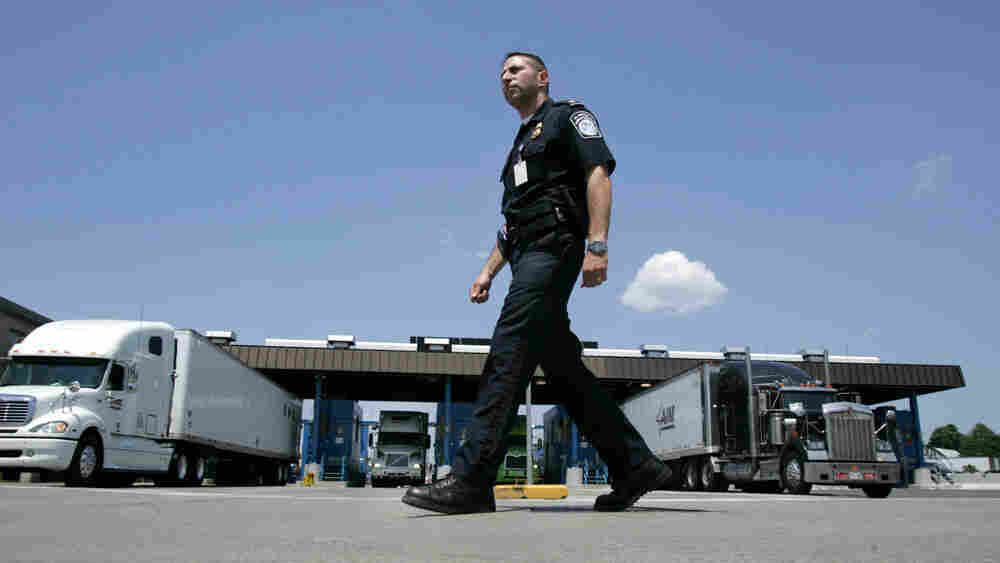 U.S. Customs and Border Protection officer Kevin Corsaro walks past a truck inspection station at the U.S. border in Buffalo, N.Y., in 2006.