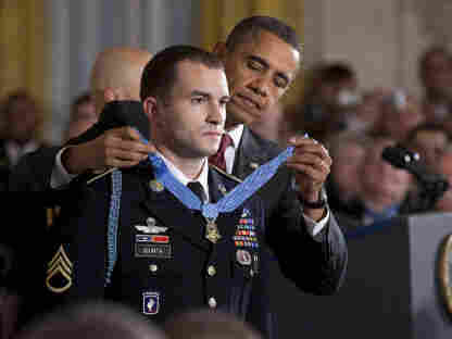 """A True Hero? President Obama presents the Medal of Honor to Staff Sgt. Salvatore Giunta in the East Room of the White House last November. Asked if he's a hero, Giunta said, """"I am only mediocre. I'm average, and by no means did I do anything that anyone else wouldn't have done in that situation."""""""