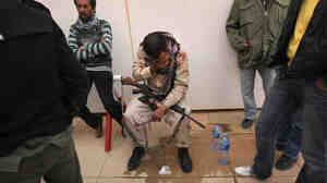 A rebel militiaman weeps after his brother was critically wounded on March 8, 2011 near Ras Lanuf, Libya.