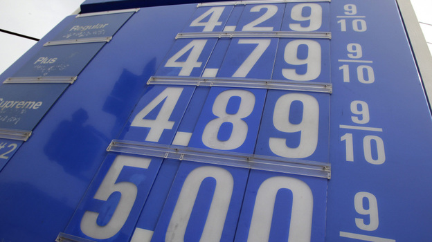 A $5 per gallon price is posted at a gas station in Belmont, Calif., on Wednesday.