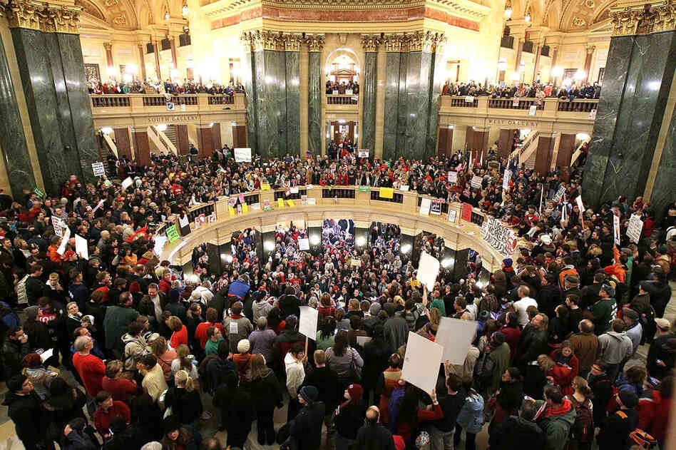 Protesters fill the Wisconsin state Capitol after Republican state senators voted to curb collective bargaining righ