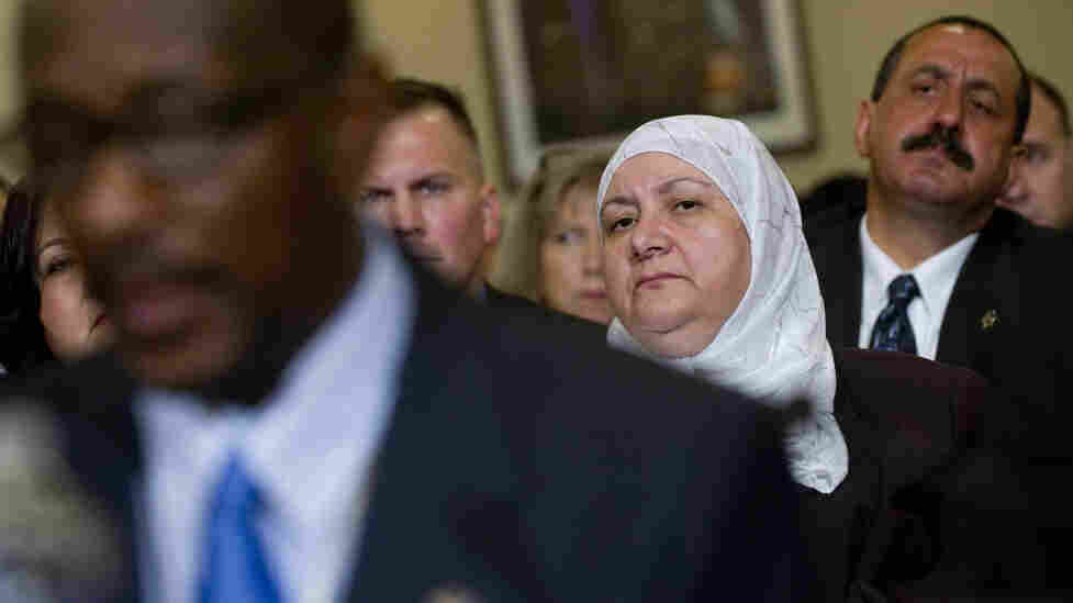 Members of the public listen Thursday as the Committee on Homeland Security holds the first in a series of hearings on radicalization in the American Muslim community.
