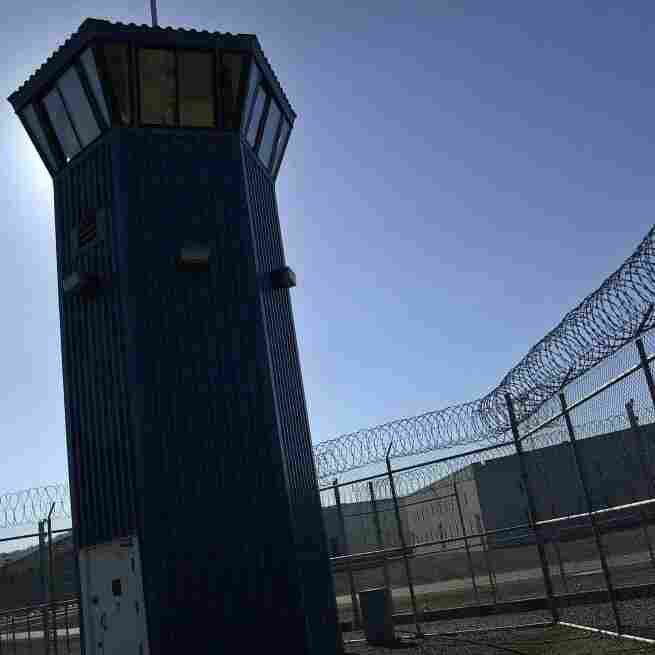 A watchtower rises above the maximum security complex at Pelican Bay State Prison in Crescent City, Calif. A guard at the prison recently described how it has changed his life.