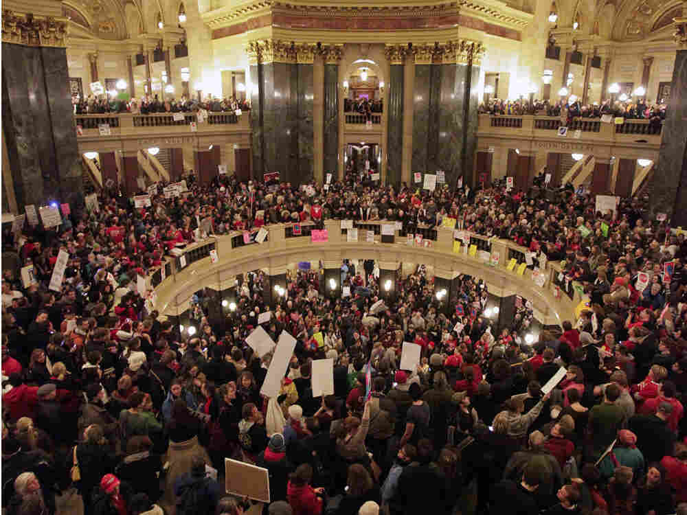 Protestors rally at the state  capital building in Madison,  Wisconsin on Wednesday. The  Wisconsin Senate voted Wednesday to strip public unions of many of their  collective bargaining rights.