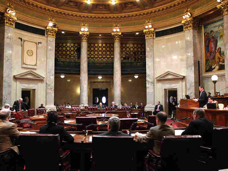 Democrats' chairs sat empty during the Senate vote on Gov. Scott Walker's legislation that would restrict collective bargaining for most government workers in Wisconsin. Republicans voted 18-1 to pass the bill.