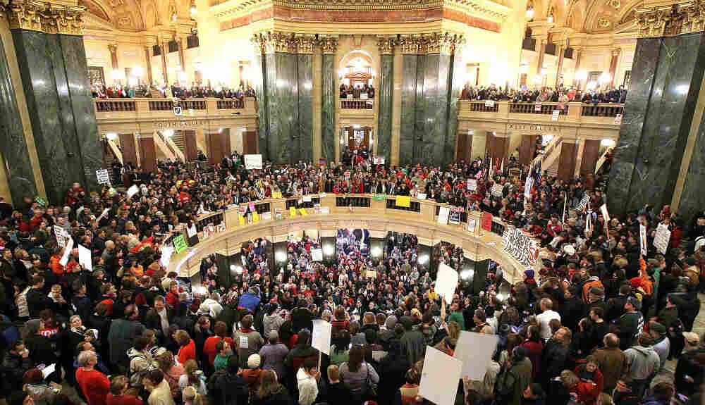 Thousands of protesters swarm the Capitol in Madison, Wis., on Wednesday after Republican senators voted to curb collective bargaining rights for some public union workers.