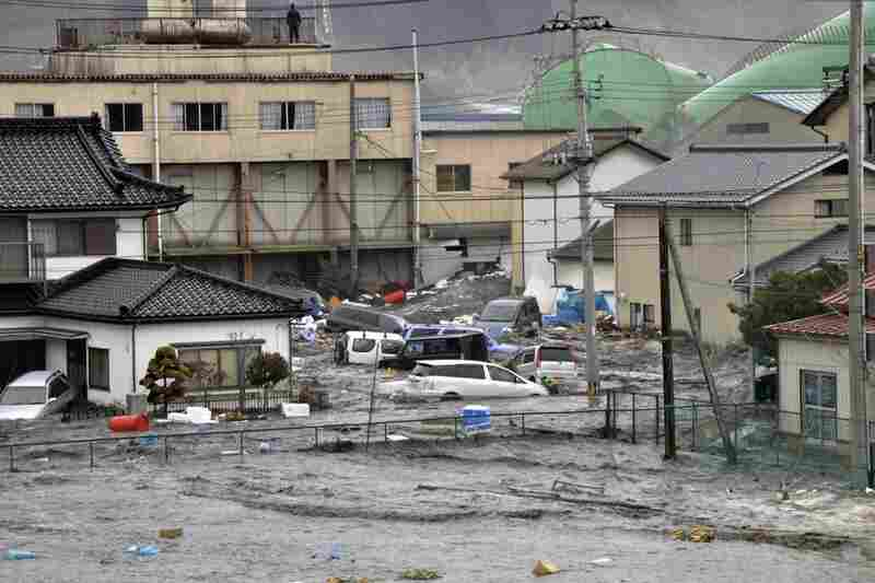Houses are flooded in Kesennuma city in Miyagi prefecture, northern Japan.