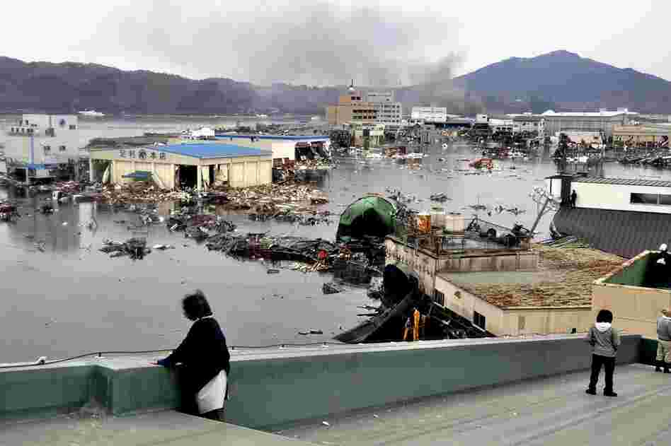A warehouse and vehicles were washed away in Kesennuma, northern Japan.