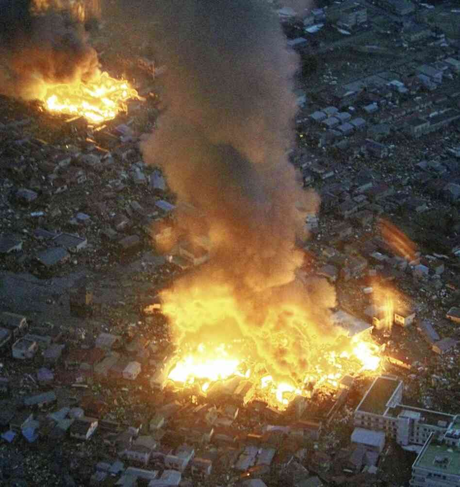 Buildings burn in Yamada town, Iwate prefecture, after Japan's biggest recorded earthquake hit.