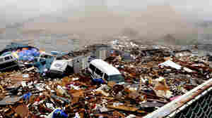 Cars and other debris swept away by tsunami tidal waves, Kesennuma in Miyagi Prefecture, northern Japan.