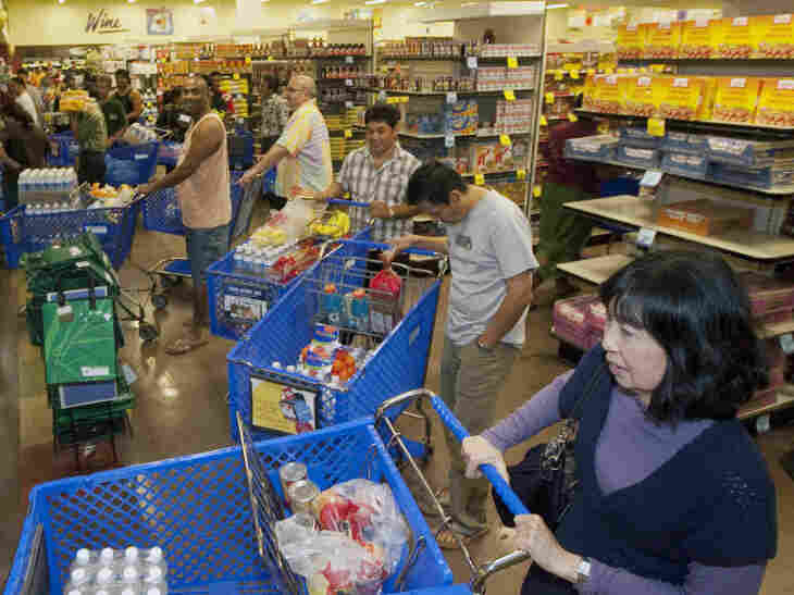 Shoppers buy water and supplies in Honolulu on Thursday, in advance of a tsunami triggered by a massive earthquake in Japan.