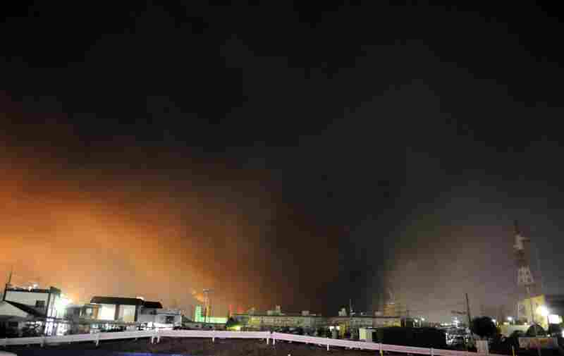 Black smoke rises from an oil industrial complex in Ichihara city, Chiba, about 50 milies east of Tokyo.