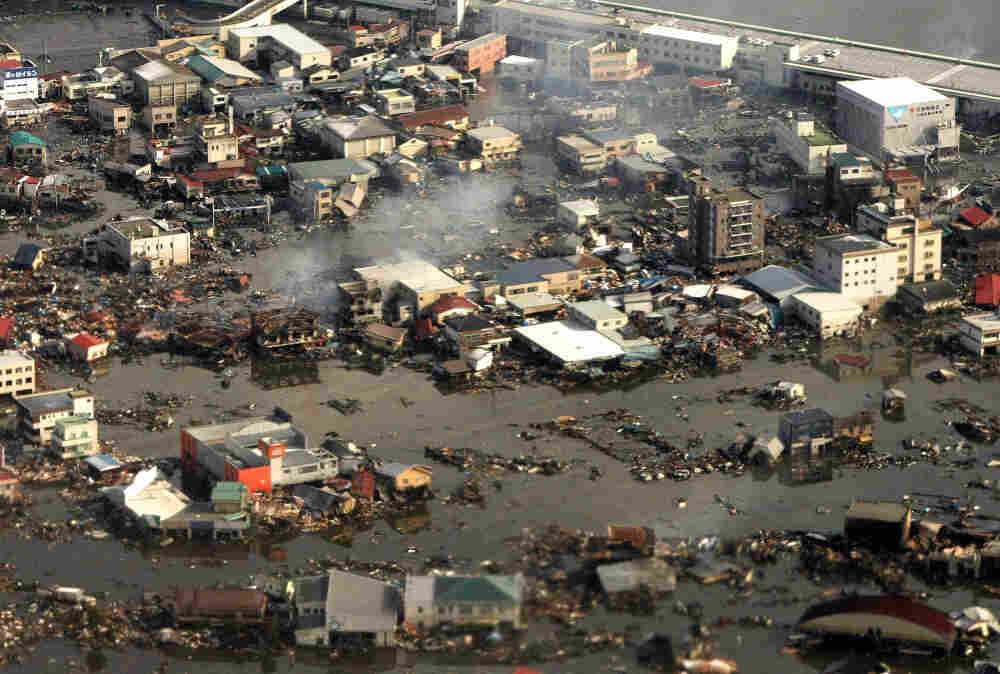An aerial view shows the devastated Kesennuma city in Miyagi prefecture on March 12, 2011. More than 1,000 people were feared dead after a monster tsunami unleashed by a massive quake which wreaked destruction across northeast Japan and triggered an emergency at a nuclear power plant.