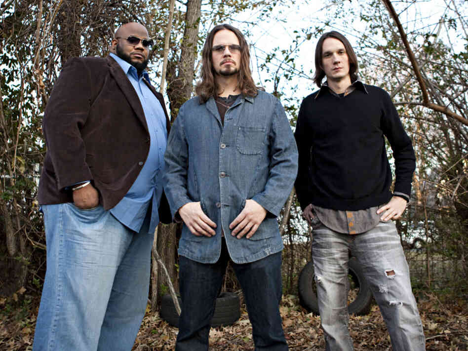 L-R: The North Mississippi Allstars' Chris Chew, Luther Dickinson and Cody Dickinson celebrate the late Jim Dickinson on Keys to the Kingdom.
